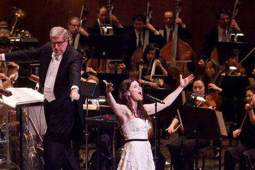 In this Feb. 5, 2011 publicity image released by the  New York Philharmonic, Marvin Hamlisch, left, conducts while Idina Menzel performs with the New York Philharmonic at Avery Fisher Hall in New York.  &#40;AP Photo&#47;New York Philharmonic,  Chris Lee&#41; <span class=meta>(AP Photo&#47; Chris Lee)</span>