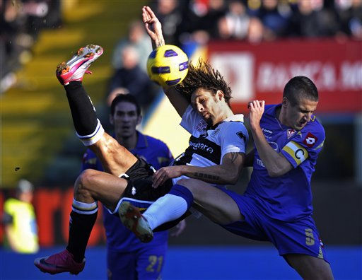 Parma&#39;s Carvalho Amauri of Brazil, left, scores past Fiorentina defender Alessandro Gamberini, during their Serie A soccer match at Parma&#39;s Tardini stadium, Italy, Sunday, Feb. 6, 2011. &#40;AP Photo&#47;Marco Vasini&#41; <span class=meta>(AP Photo&#47; Marco Vasini)</span>