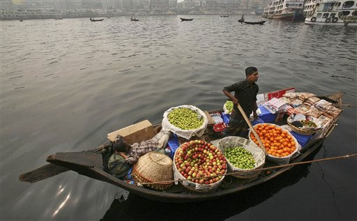 A vendor waits for customers at his vegetable shop in a boat on the Buriganga River during a nationwide strike in Dhaka, Bangladesh, Monday, Feb. 7, 2011. Police fired tear gas and arrested dozens in northwestern Bangladesh Monday as the country&#39;s main opposition party enforced a dawn-to-dusk general strike to protest the government&#39;s alleged failure to run the nation effectively. &#40;AP Photo&#47;Pavel Rahman&#41; <span class=meta>(AP Photo&#47; Pavel Rahman)</span>
