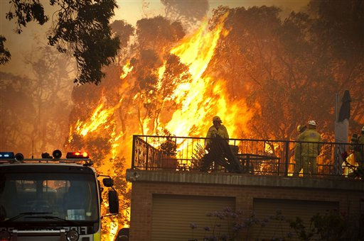 In this Feb. 6, 2011 photo made available Feb. 8, and provided by the Fire &amp; Emergency Services Authority of Western Australia, Gosnell firefighters battles a wildfire at the rear of a house in the Perth, Australia, suburb of Roleystone. Police said at least 68 homes were lost in the blaze, believed to have been started by sparks from an angle grinder. &#40;AP Photo&#47;FESA, Evan Collis&#41; EDITORIAL USE ONLY <span class=meta>(AP Photo&#47; Evan Collis)</span>