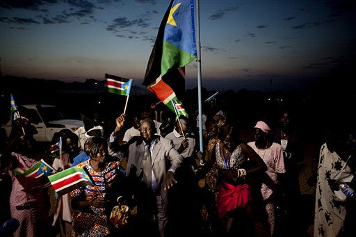 Southern Sudanese celebrate the formal announcement of independence referendum results in the southern capital of Juba on Monday, Feb. 7, 2011. Referendum officials indicated that nearly 99 percent of all voters cast ballots in favor of southern independence. Southern Sudan will remain  united with the north until the expiration of Comprehensive Peace Agreement in July 2011. &#40;AP Photo&#47;Pete Muller&#41; <span class=meta>(AP Photo&#47; Pete Muller)</span>
