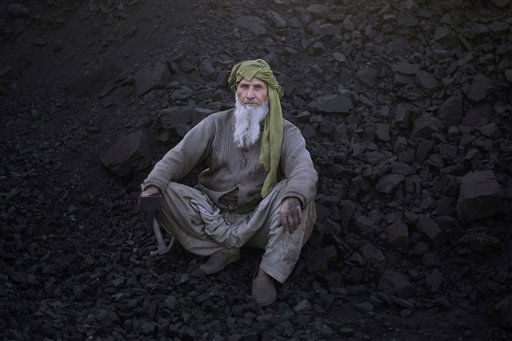 Pakistani Ghull Mohammed, 68, looks on while taking a break from breaking coal in a brick factory on the outskirts of Islamabad, Pakistan, Tuesday, Feb. 8, 2011. &#40;AP Photo&#47;Muhammed Muheisen&#41; <span class=meta>(AP Photo&#47; Muhammed Muheisen)</span>