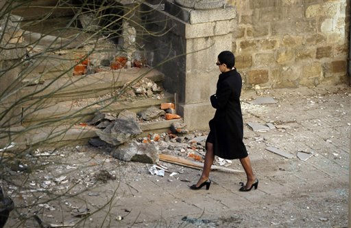 "<div class=""meta ""><span class=""caption-text "">Cristina Patrashkove, editor-in-chief of the Bulgarian weekly newspaper Galeria, walks through debris at the newspaper's office in downtown Sofia, Thursday, Feb. 10, 2011.  A makeshift bomb exploded Thursday at the office of the Bulgarian newspaper, causing damages but no injuries, hours before a European Union commissioner was to arrive in the country's capital.(AP Photo/Valentina Petrova) (AP Photo/ Valentina Petrova)</span></div>"