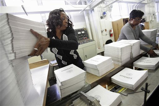 Willow Wimbush, left, and Nancy Harris, work on copies of the Appendix of the fiscal 2012 federal budget, Thursday, Feb. 10, 2011, at the U.S. Government Printing Office (GPO) in Washington. (AP Photo/Jacquelyn Martin)
