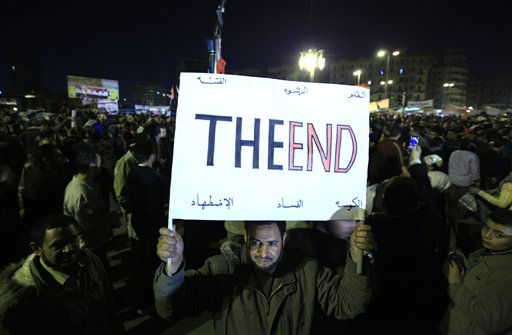 An Egyptian Anti-government protester marches with a banner reading &#34;the end&#34;  as he  celebrates in Tahrir Square in downtown Cairo, Egypt Thursday, Feb. 10, 2011. Egypt&#39;s military announced on national television it had stepped in to secure the country and promised protesters calling for President Hosni Mubarak&#39;s ouster that all their demands would soon be met. Tens of thousands of protesters packed in central Tahrir broke into chants of &#39;We&#39;re almost there, we&#39;re almost there&#39; and waved V-for-victory signs as thousands more flowed in to join them well after nightfall. &#40;AP Photo&#47;Amr Nabil&#41; <span class=meta>(AP Photo&#47; Amr Nabil)</span>