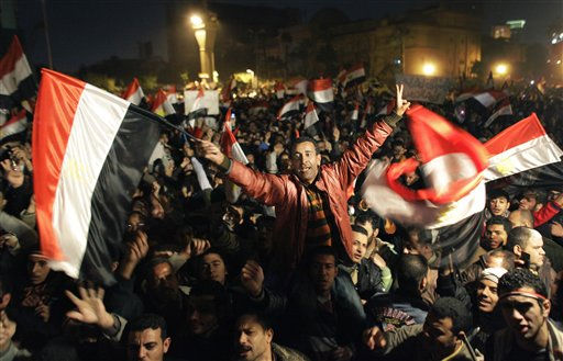 Egyptians celebrate the news of the resignation of President Hosni Mubarak, who handed control of the country to the military, at night in Tahrir Square in downtown Cairo, Egypt Friday, Feb. 11, 2011. &#40;AP Photo&#47;Ben Curtis&#41; <span class=meta>(AP Photo&#47; Ben Curtis)</span>