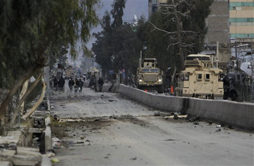 "<div class=""meta ""><span class=""caption-text "">Afghan police and US soldiers secure the headquarters of the police station after an attack in the center of Kandahar, south of Kabul, Afghanistan, Sunday, Feb. 13, 2011. Taliban insurgents wearing explosive vests attacked the police headquarters on Saturday, unleashing an arsenal of car bombs, automatic rifle fire and rocket-propelled grenades. At least 18 people where killed, most of them police officers.  (AP Photo/Anja Niedringhaus) (AP Photo/ Anja Niedringhaus)</span></div>"