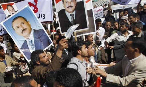 Yemeni anti-government protestors, right, scuffle with government supporters during a rally demanding political reform and the resignation of President Ali Abdullah Saleh in Sanaa, Yemen, Sunday, Feb. 13, 2011. Yemeni police have clashed with anti-government protesters demanding political reform and the resignation of President Ali Abdullah Saleh. Several thousand protesters, many of them university students, tried to reach the central square in the capital of Sanaa on Sunday, but were pushed back by police using clubs. It was the third straight day of anti-government protests. &#40;AP Photo&#47;Hani Mohammed&#41; <span class=meta>(AP Photo&#47; Hani Mohammed)</span>