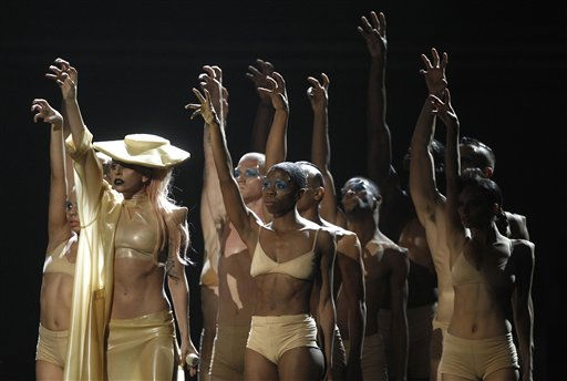 "<div class=""meta image-caption""><div class=""origin-logo origin-image ""><span></span></div><span class=""caption-text"">Lady Gaga, left, performs at the 53rd annual Grammy Awards on Sunday, Feb. 13, 2011, in Los Angeles. (AP Photo/Matt Sayles)   (Photo/Matt Sayles)</span></div>"