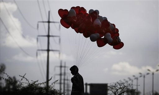 A Pakistani selling balloons on Valentine&#39;s day crosses a street looking for customers in Islamabad, Pakistan, Monday, Feb. 14, 2011. &#40;AP Photo&#47;Muhammed Muheisen&#41; <span class=meta>(AP Photo&#47; Muhammed Muheisen)</span>