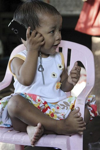 Lei Yadi Min, aged over 1 year-old baby girl, sits and plays on a chair at her house in southern outskirts of Yangon, Tuesday, Feb.15, 2011, in Yangon, Myanmar. A Myanmar girl has entered the record books for having 12 fingers - six each hand, and 14 toes - 7 each foot.&#40;AP Photo&#47;Khin Maung Win&#41; <span class=meta>(AP Photo&#47; Khin Maung Win)</span>