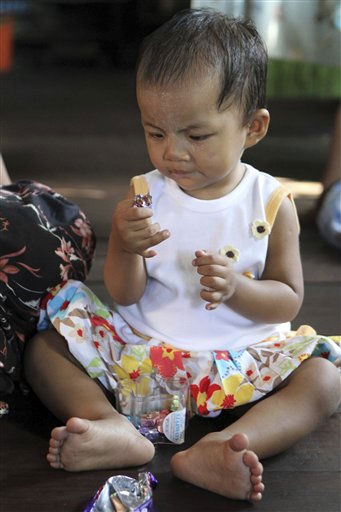 Lei Yadi Min, aged over 1 year-old baby girl, plays at her house in southern outskirts of Yangon, Tuesday, Feb.15, 2011, in Yangon, Myanmar. A Myanmar girl has entered the record books for having 12 fingers - six each hand, and 14 toes - 7 each foot.&#40;AP Photo&#47;Khin Maung Win&#41; <span class=meta>(AP Photo&#47; Khin Maung Win)</span>
