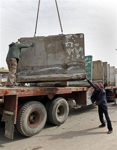 Municipality workers remove concrete blast walls in Baghdad, Iraq, Wednesday, Feb. 16, 2011. Baghdad is considered safe enough in many places to take down more of the thick concrete blast walls that line many streets and surround buildings in the city, officials said. &#40;AP Photo&#47;Hadi Mizban&#41; <span class=meta>(AP Photo&#47; Hadi Mizban)</span>