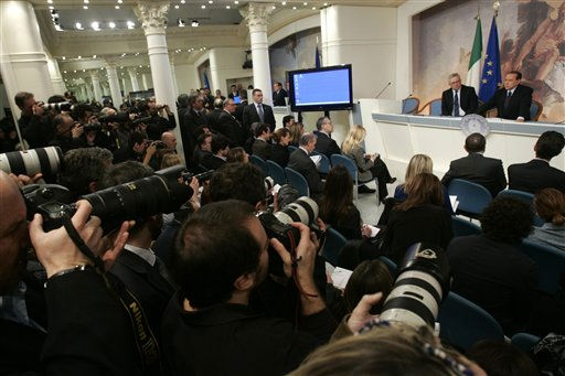 Italian Premier Silvio Berlusconi, right, and Finance Minister Giulio Tremonti, face a  press conference at Chigi Premier&#39;s palace, in Rome, Wednesday, Feb. 16, 2011. Berlusconi says he is not worried by an impending prostitution trial, in his first public comments since he was indicted. The 74-year-old Italian leader was ordered Tuesday to stand trial on charges he paid a 17-year-old Moroccan girl for sex, and then used his influence to cover it up. &#40;AP Photo&#47;Riccardo De Luca&#41; <span class=meta>(AP Photo&#47; Riccardo De Luca)</span>