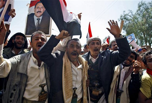 Supporters of the Yemeni government shout slogans as they try to enter Sanaa University where anti-government protestors gather, in Sanaa, Yemen, Wednesday, Feb. 16, 2011. Yemen sent 2,000 policemen into the streets of the capital on Wednesday to try to put down days of protests against the president of 32 years, a key U.S. ally in battling al-Qaida.The policemen, including plainclothes officers, fired in the air and blocked thousands of students at Sanaa University from joining thousands of other protesters elsewhere in the capital who were holding a sixth straight day of demonstrations. &#40;AP Photo&#47;Hani Mohammed&#41; <span class=meta>(AP Photo&#47; Hani Mohammed)</span>