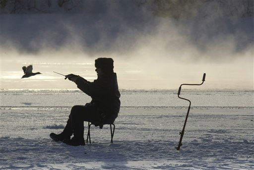 A man fishes on an ice-pack of the Moskva River in Moscow, Russia, Thursday, Feb. 17, 2011.  Cold weather has blanketed the Moscow region with temperatures reaching around   -15 C &#40;5F&#41; dropping to -22 C &#40;-8F&#41; overnight. &#40;AP Photo&#47;Mikhail Metzel&#41; <span class=meta>(AP Photo&#47; Mikhail Metzel)</span>