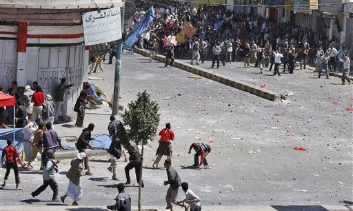 Yemeni anti-government demonstrators, top right, and government supporters, hurl stones at each other during clashes in Sanaa, Yemen, Thursday, Feb. 17, 2011.  Police opened fire on protesters during clashes in a southern Yemeni port, killing two people, in the first known deaths in six days of demonstrations across the country&#39;s biggest cities, demanding the ousting of President Ali Abdullah Saleh. &#40;AP Photo&#47;Hani Mohammed&#41; <span class=meta>(AP Photo&#47; Hani Mohammed)</span>