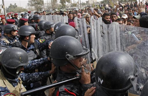 Iraqi riot police officers prevent anti-government protesters from entering the Basra provincial headquarters during a demonstration in Basra, Iraq&#39;s second-largest city, 550 kilometers &#40;340 miles&#41; southeast of Baghdad, Iraq, Thursday, Feb. 17, 2011.  Hundreds of Iraqi demonstrators massed in the southern city of Basra to demand the ousting of the local governor, a day after a similar anti-government protest sparked violence that killed a few people. &#40;AP Photo&#47;Nabil al-Jurani&#41; <span class=meta>(AP Photo&#47; Nabil al-Jurani)</span>
