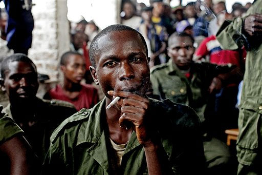 "<div class=""meta ""><span class=""caption-text "">Sido Bizinungu, a close associate of Lt. Col. Mutuare Daniel Kibibi, smokes a cigarette after being convicted of crimes against humanity in the town of Baraka, Congo Monday, Feb. 21, 2011. Nearly 50 women poured out their stories in a wave of anguish that ended Monday with the conviction of an army colonel for crimes against humanity _ a landmark verdict in this Central African country where thousands are believed to be raped each year by soldiers and militia groups who often go unpunished. (AP Photo/Pete Muller) (AP Photo/ Pete Muller)</span></div>"