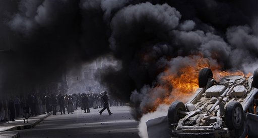"<div class=""meta ""><span class=""caption-text "">Supporters of the Yemeni government seen through the smoke of a burning vehicle belonging to them destroyed and set on fire by anti-government demonstrators during clashes in Sanaa, Yemen, Tuesday, Feb. 22, 2011. Yemen's embattled leader rejects demands that he step down, calling demonstrations against his regime unacceptable acts of provocation and offers to begin a dialogue with protesters. (AP Photo/Muhammed Muheisen) (AP Photo/ Muhammed Muheisen)</span></div>"