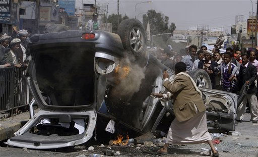"<div class=""meta ""><span class=""caption-text "">A Yemeni anti-government demonstrator throws sand on a burning vehicle belonging to supporters of President Ali Abdullah Saleh during clashes in Sanaa, Yemen, Tuesday, Feb. 22, 2011. Yemen's embattled leader rejects demands that he step down, calling demonstrations against his regime unacceptable acts of provocation and offers to begin a dialogue with protesters. (AP Photo/Muhammed Muheisen) (AP Photo/ Muhammed Muheisen)</span></div>"