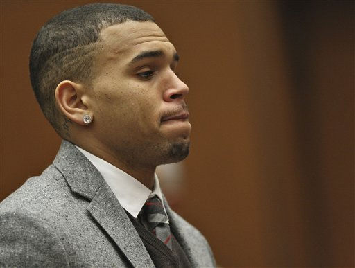R&#38;B singer Chris Brown petitions a Los Angeles judge to ease a restraining order in his past Rihanna assault case on Tuesday, Feb. 22, 2011, in Los Angeles. Los Angeles Superior Court Judge Patricia Schnegg downgraded a restraining order issued in Brown&#39;s felony assault case that had kept him at least 50 yards from her except during public events. Brown remains on probation after pleading guilty to assaulting his then-girlfriend during a fight in Feb. 2009 after a pre-Grammy Awards party. &#40;AP Photo&#47;David McNew, Pool&#41; <span class=meta>(AP Photo&#47; David McNew)</span>