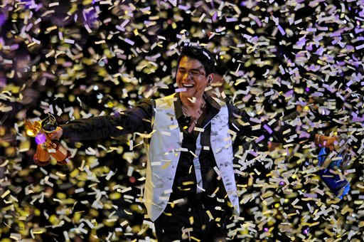 Confetti rains down on Chilean singer Americo after the audience rewarded him with a gold and a silver torch as well as a Silver Seagull award on the second night of the Vi&#241;a del Mar International Song Festival at the Quinta Vergara Amphitheater in Vi&#241;a del Mar, Chile, Monday Feb. 21, 2011. Believed to be one of the largest musical events in Latin America, the annual 5-day festival was inaugurated in 1960. &#40;AP Photo&#47;Jorge Sanchez&#41; <span class=meta>(AP Photo&#47; Jorge Sanchez)</span>