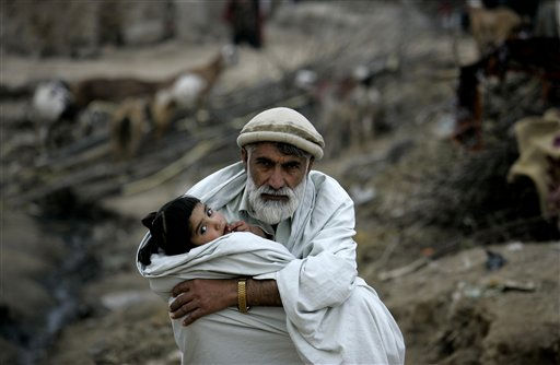 "<div class=""meta ""><span class=""caption-text "">Saboor Khan who fled his village due to fighting between security forces and militants in Pakistan's tribal area of Bajur, waits for transport to take his ailing daughter to a doctor, in slums of Islamabad, Pakistan on Wednesday, Feb. 23, 2011. (AP Photo/B.K.Bangash) (AP Photo/ B.K.Bangash)</span></div>"
