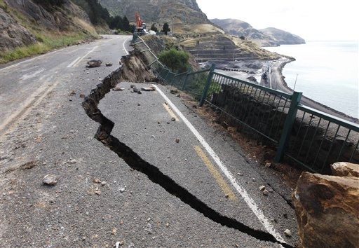 Part of a road between Lyttelton and Sumner is damaged by Tuesday&#39;s earthquake on the outskirts of Christchurch, New Zealand, Thursday, Feb. 24, 2011. The magnitude-6.3 temblor collapsed buildings, caused extensive other damage and killed dozens of people in the city. &#40;AP Photo&#47;Mark Baker&#41; <span class=meta>(AP Photo&#47; Mark Baker)</span>