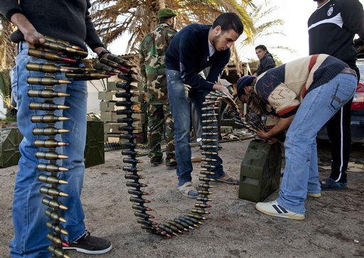 Libyan militia members who are now part of the forces against Libyan leader Moammar Gadhafi organize ammunition at a military base in Benghazi, in eastern Libya, Monday, Feb. 28, 2011. &#40;AP Photo&#47;Kevin Frayer&#41; <span class=meta>(AP Photo&#47; Kevin Frayer)</span>