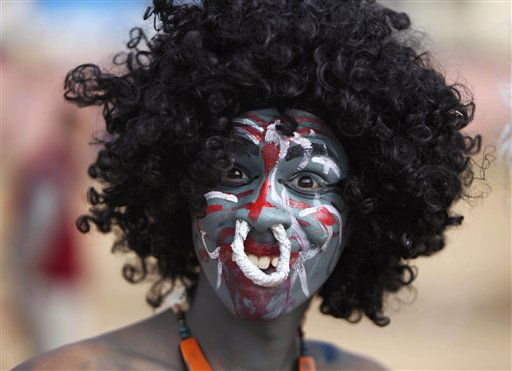 A Hindu devotee dressed as a demon participates in a procession on the eve of Shivratri festival, in Jammu, India, Tuesday, March 1, 2011. Shivratri, a festival dedicated to the worship of Hindu God Shiva, will be marked across the country Wednesday. &#40;AP Photo&#47;Channi Anand&#41; <span class=meta>(AP Photo&#47; Channi Anand)</span>