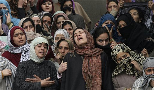 Relatives of civilian Showkat Ali Khan wail during his funeral in Srinagar, India, Tuesday, March 1, 2011. Khan, who was seriously injured in a grenade attack by suspected militants in Batamaloo area, succumbed to his injuries early Tuesday morning. Khan and two policemen were injured when suspected militants hurled a grenade towards a police post. &#40;AP Photo&#47;Mukhtar Khan&#41; <span class=meta>(AP Photo&#47; Mukhtar Khan)</span>