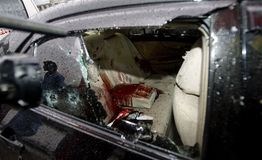 "<div class=""meta image-caption""><div class=""origin-logo origin-image ""><span></span></div><span class=""caption-text"">A Pakistani cameraman films the blood-stained damaged car of slain Pakistan's government minister for religious minorities Shahbaz Bhatti outside the emergency ward of a local hospital in Islamabad, Pakistan on Wednesday, March 2, 2011. Gunmen shot and killed Bhatti, the latest attack on a high-profile Pakistani figure threatened by Islamist militants for urging reform of harsh blasphemy laws that impose the death penalty for insulting Islam. (AP Photo/Anjum Naveed) (AP Photo/ Anjum Naveed)</span></div>"
