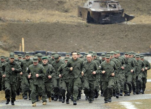 Georgian President Mikhail Saakashvili, center, takes part in a training at Georgian Special Forces training center outside Tbilisi, Georgia, Wednesday, March 2, 2011. &#40;AP Photo&#47; Irakli Gedenidze, Presidential Press Service, pool &#41; <span class=meta>(AP Photo&#47; Irakli Gedenidze)</span>