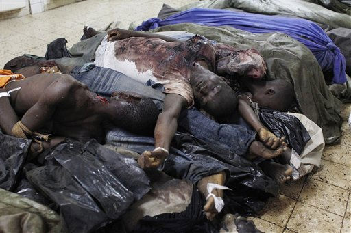 "<div class=""meta ""><span class=""caption-text "">**EDS NOTE: GRAPHIC CONTENT** The bodies of dozens of young men killed in recent clashes lie piled on the floor of a morgue, in Abidjan, Ivory Coast Wednesday, March 2, 2011. More than 50 people have been killed in the last week by fighting between supporters of rival presidential claimants Alassane Ouattara and Laurent Gbagbo. Since December, hundreds of bodies have been piling up in overcrowded morgues across the city, as the government controlled by Gbagbo has not given the go ahead for the autopsies necessary to release them for burial. (AP Photo/Rebecca Blackwell) (AP Photo/ Rebecca Blackwell)</span></div>"