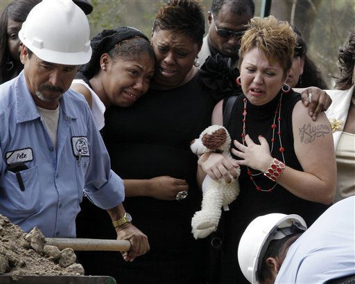 Surrounded by family, Tiffany Dickerson, right, cries at the gravesite of her son Shomari Dickerson, Thursday, March 3, 2011, in Houston. The 3-year-old died in a day care fire Feb. 24. &#40;AP Photo&#47;Pat Sullivan&#41; <span class=meta>(AP Photo&#47; Pat Sullivan)</span>