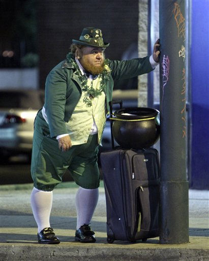 In this March 5, 2011 photo, an unidentified man dressed as a leprechaun waits for a bus along Frankford Avenue in the Mayfair section of Northeast Philadelphia.  A pub crawl called the Shamrock Shuttle was taking place along several blocks of Frankford Ave. &#40;AP Photo&#47; Joseph Kaczmarek&#41; <span class=meta>(AP Photo&#47; Joseph Kaczmarek)</span>