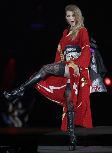A model shows kimono designed by Japanese music star Yoshiki during the Asia Girls Explosion fashion event produced by the musician in Tokyo Sunday, March 6, 2011. &#40;AP Photo&#47;Shizuo Kambayashi&#41; <span class=meta>(AP Photo&#47; Shizuo Kambayashi)</span>