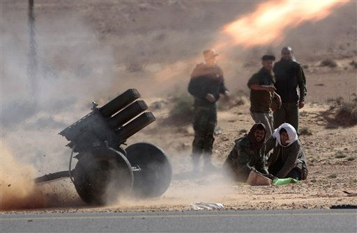 "<div class=""meta ""><span class=""caption-text "">Anti-Libyan Leader Moammar Gadhafi rebels, fire multiple launcher rockets during a fighting against pro-Gadhafi fighters near the town of Bin-Jawad, eastern Libya, Sunday, March 6, 2011.  Thousands of Moammar Gadhafi's supporters poured into the streets of Tripoli on Sunday, waving flags and firing their guns into the air in the Libyan leader's main stronghold. Earlier, the city woke to the crackle of heavy machine-gun fire that rattled the capital before dawn.(AP Photo/Hussein Malla) (AP Photo/ Hussein Malla)</span></div>"