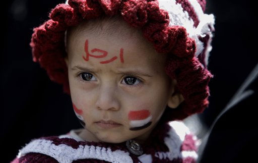 "<div class=""meta ""><span class=""caption-text "">Yemeni girl Mariam Mohammed, 2, is held by her mother during a demonstration by anti-government protestors demanding the resignation of Yemeni President Ali Abdullah Saleh, in Sanaa, Yemen, Sunday, March 6, 2011. Suspected al-Qaida gunmen killed four Republican Guard soldiers on Sunday in the mountainous central province of Marib, security officials said. Also Sunday, the U.S. government, citing terrorism and civil unrest, advised Americans not to travel to Yemen and said Americans already in the impoverished Arab nation should leave. A travel warning issued by the State Department also authorized family members of U.S. Embassy staff and non-essential personnel to leave. Arabic on her face reads, ""Leave"". (AP Photo/Muhammed Muheisen) (AP Photo/ Muhammed Muheisen)</span></div>"