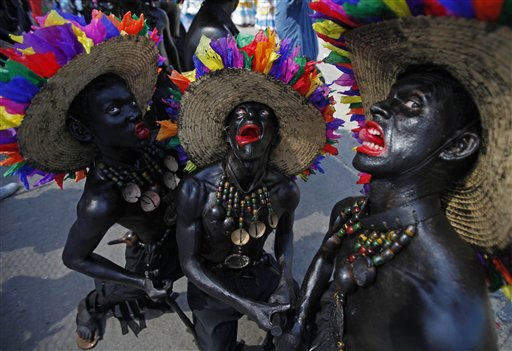 Revelers perform during carnival celebrations in Barranquilla, Colombia, Sunday March 6, 2011. In 2003 the United Nations Educational, Scientific and Cultural Organization, UNESCO, declared Barranquilla&#39;s carnival as a &#34;Masterpiece of Oral and Intangible Heritage of Humanity.&#34; &#40;AP Photo&#47;Fernando Vergara&#41; <span class=meta>(AP Photo&#47; Fernando Vergara)</span>