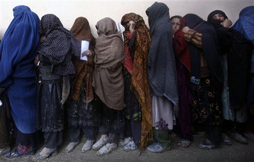 Afghan refugee women from Helmand, wait for their turn to receive free ration at World Food Program &#40;WFP&#41; distribution center in Kabul, Afghanistan, Monday, March 7, 2011. In the last four months WFP has provided food rations to hundreds of thousands of Afghan families mostly widows, refugees, the disabled and poor families. &#40;AP Photo&#47;Dar Yasin&#41; <span class=meta>(AP Photo&#47; Dar Yasin)</span>