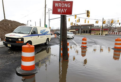 Commuters go off road to get through water accumulated at Main Street and Route 46, where high water forced the closure of Main Street after an overnight storm, Monday, March 7, 2011, in Lodi, N.J. &#40;AP Photo&#47;Julio Cortez&#41; <span class=meta>(AP Photo&#47; Julio Cortez)</span>
