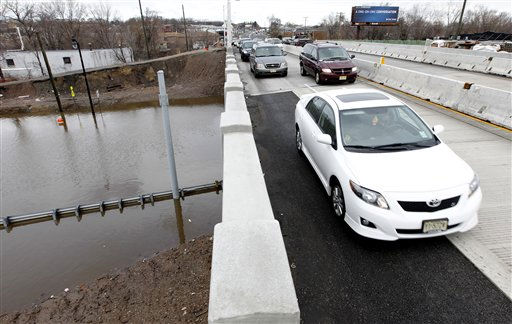 High water is seen on Main Street as commuters make their way on the Route 46 overpass, Monday, March 7, 2011, in Lodi, N.J. High water accumulated on the street, forcing its closure following an overnight storm. &#40;AP Photo&#47;Julio Cortez&#41; <span class=meta>(AP Photo&#47; Julio Cortez)</span>
