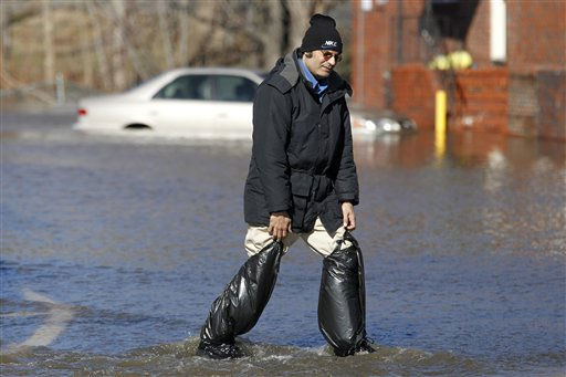 Khamlesh Bhatt negotiates flood waters while wearing makeshift water boots made from trash bags, Monday, March 7, 2011, in Lodi, N.J. An overnight storm caused the Saddle River to overflow its banks. &#40;AP Photo&#47;Julio Cortez&#41; <span class=meta>(AP Photo&#47; Julio Cortez)</span>