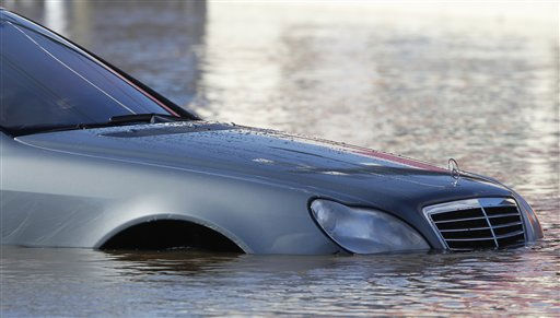 A stranded vehicle is seen in high water on Main Street in Lodi, N.J., where high waters from an overnight storm forced the street closure, Monday, March 7, 2011. The flooding was caused when the Saddle River overflowed its banks. &#40;AP Photo&#47;Julio Cortez&#41; <span class=meta>(AP Photo&#47; Julio Cortez)</span>