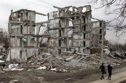 "<div class=""meta ""><span class=""caption-text "">Chechen women pass by a destroyed building in the Zavodskoi district of Grozny, Chechnya, Monday, March 7, 2011.  (AP Photo/Sergey Ponomarev) (AP Photo/ Sergey Ponomarev)</span></div>"