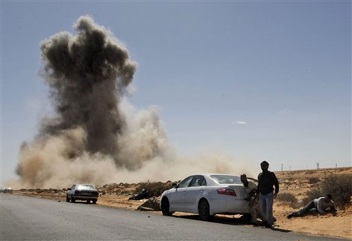"<div class=""meta ""><span class=""caption-text "">Smoke raises following an air strike by Libyan warplanes near a checkpoint near to the anti-Libyan Leader Moammar Gadhafi rebels checkpoint in the oil town of Ras Lanouf, eastern Libya, Monday, March 7, 2011.Forces loyal to Moammar Gadhafi have launched an airstrike against a rebel position in a key oil port. There were no casualties in the Monday morning attack in Ras Lanouf.Libyan rebels say they are regrouping after forces loyal to Gadhafi pounded opposition fighters with helicopter gunships, artillery and rockets on Sunday to stop the rebels' rapid advance toward the capital. (AP Photo/Hussein Malla) (AP Photo/ Hussein Malla)</span></div>"