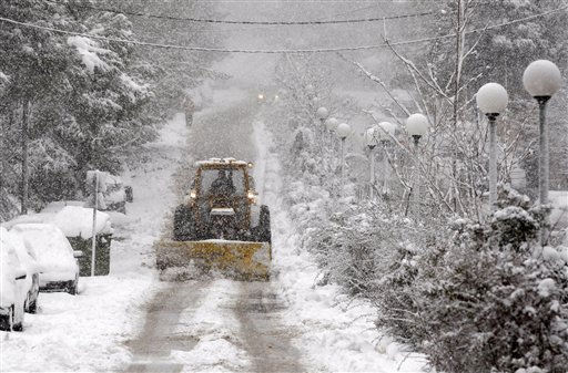 "<div class=""meta ""><span class=""caption-text "">A plough clears snow from a road in the northern Athens' suburb of Dionyssos, Tuesday, March 8, 2011. Civil defense authorities were on alert, and problems with power were reported across the country. Most of the schools in the northern parts of the Greek capital were closed and ferries were confined to the ports ahead of the strong winds. (AP Photo/Thanassis Stavrakis) (AP Photo/ Thanassis Stavrakis)</span></div>"