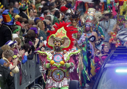 A marching group arrives at Canal Street as it marches ahead of the Krewe of Zulu on Mardi Gras Day in New Orleans, Tuesday, March 8, 2011. &#40;AP Photo&#47;Gerald Herbert&#41; <span class=meta>(AP Photo&#47; Gerald Herbert)</span>